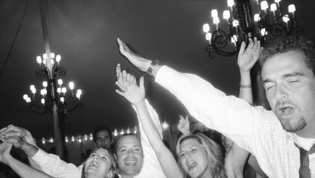 Group of friends celebrating at wedding (B&W)
